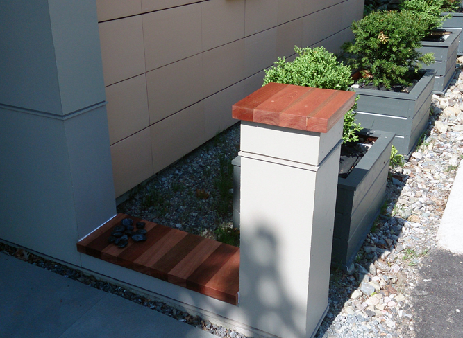 This mahogany used on this post and garden wall give the space an elegant look.