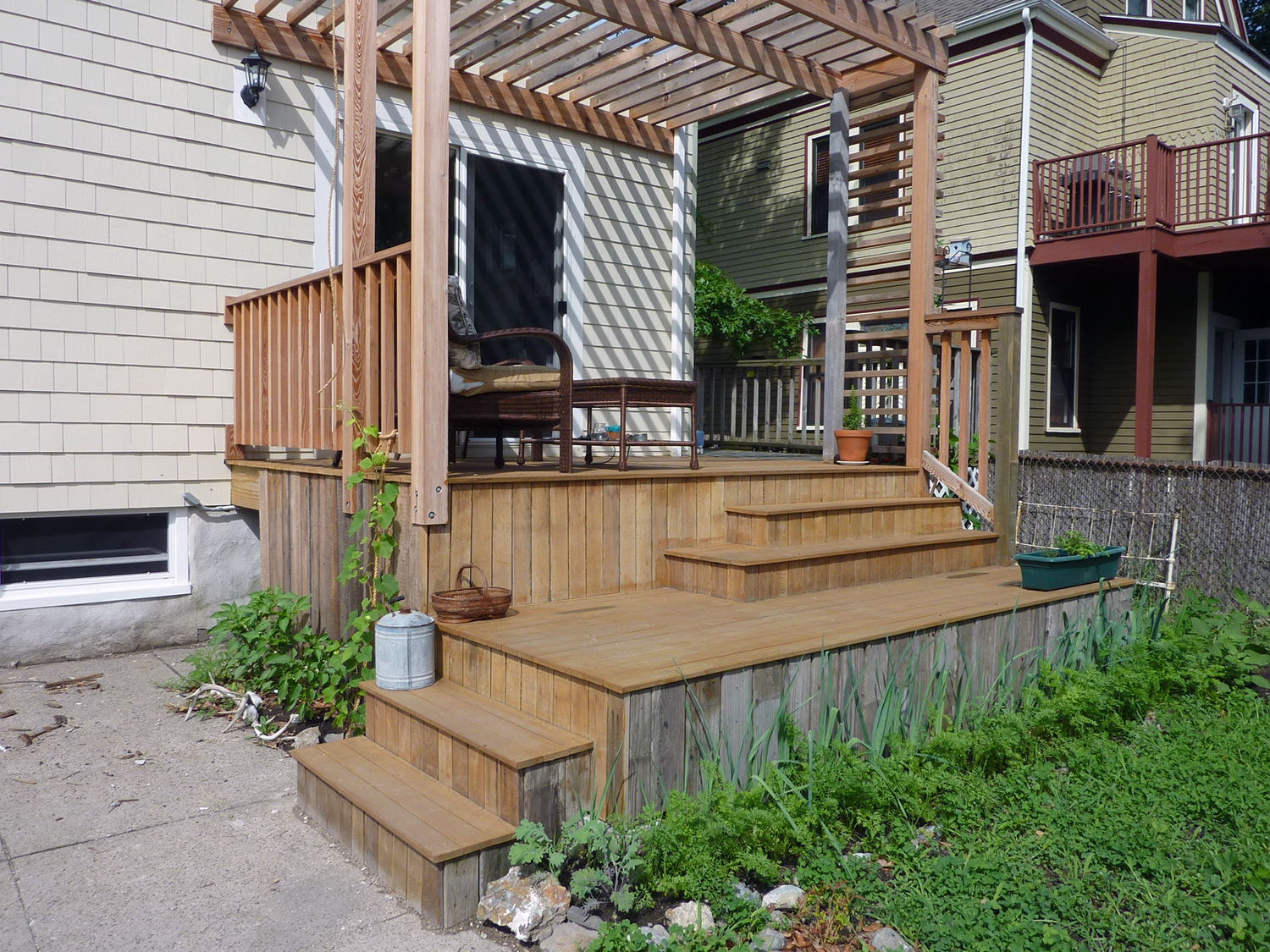 Cora's back deck is made of reclaimed lumber.