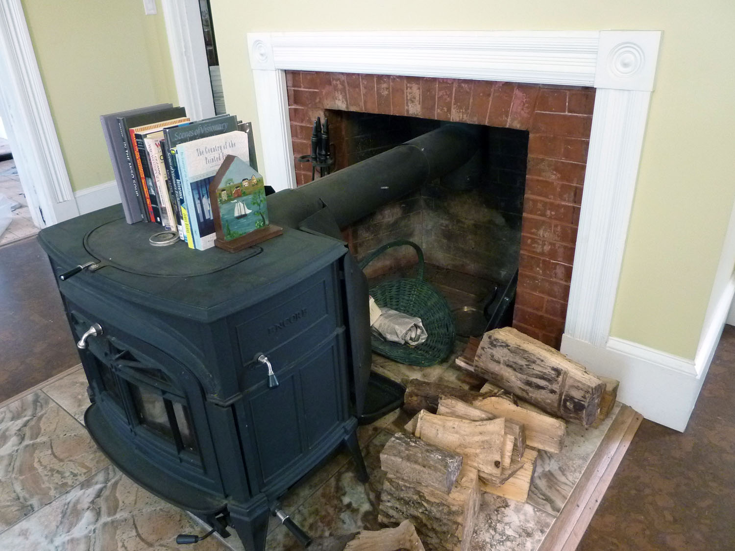 Casing from the house was reused to trim around the fireplace.