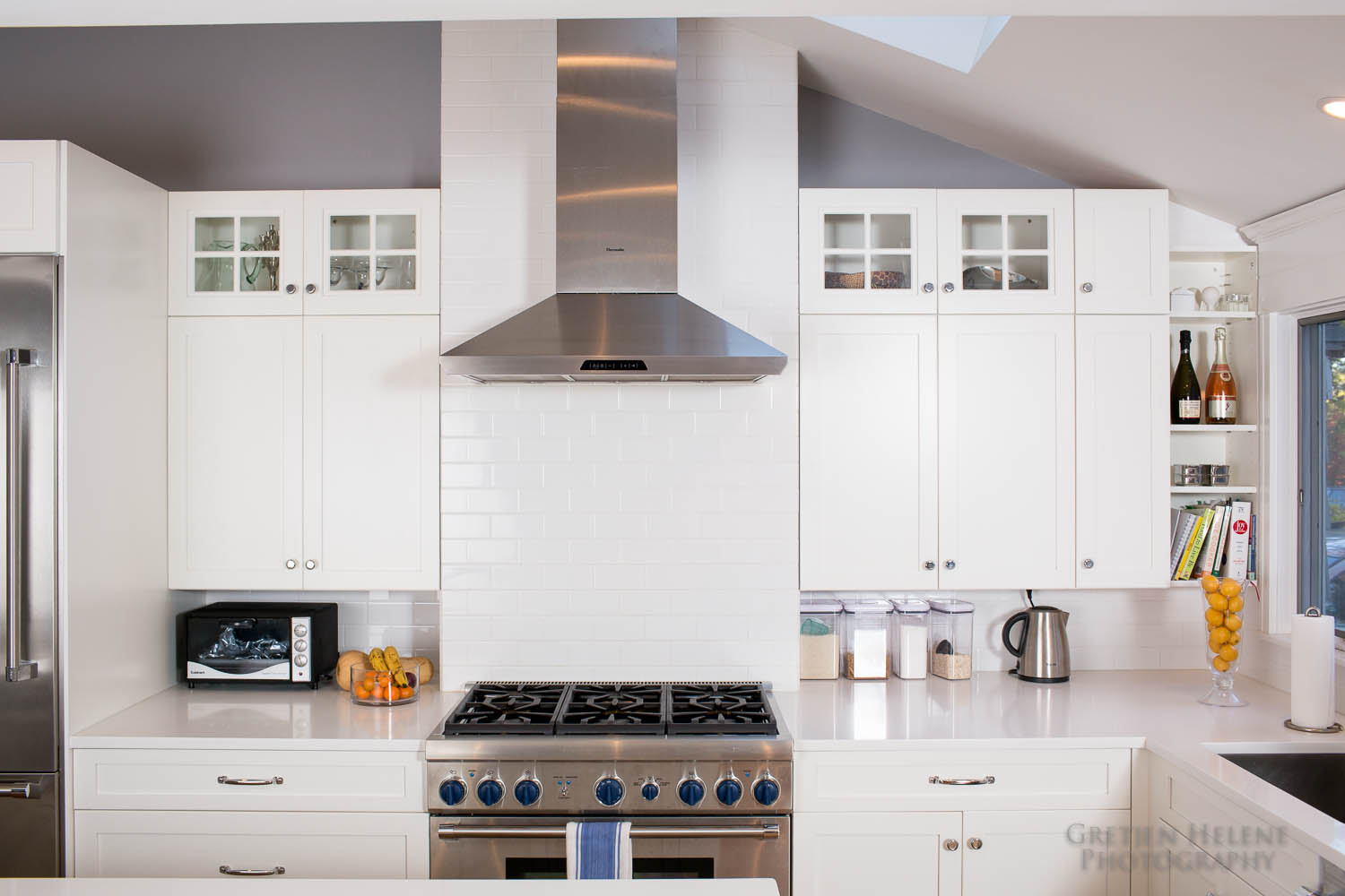 White subway tile is used for the backsplash.
