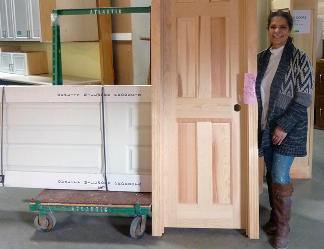 "Evilyn Kalil picked up a bare wood door and a primed door. ""It would have cost me a lot more somewhere else."""
