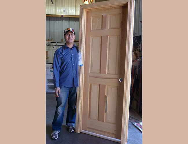 Mission Hill resident Sam Liu picked up two unfinished doors for his home renovation.
