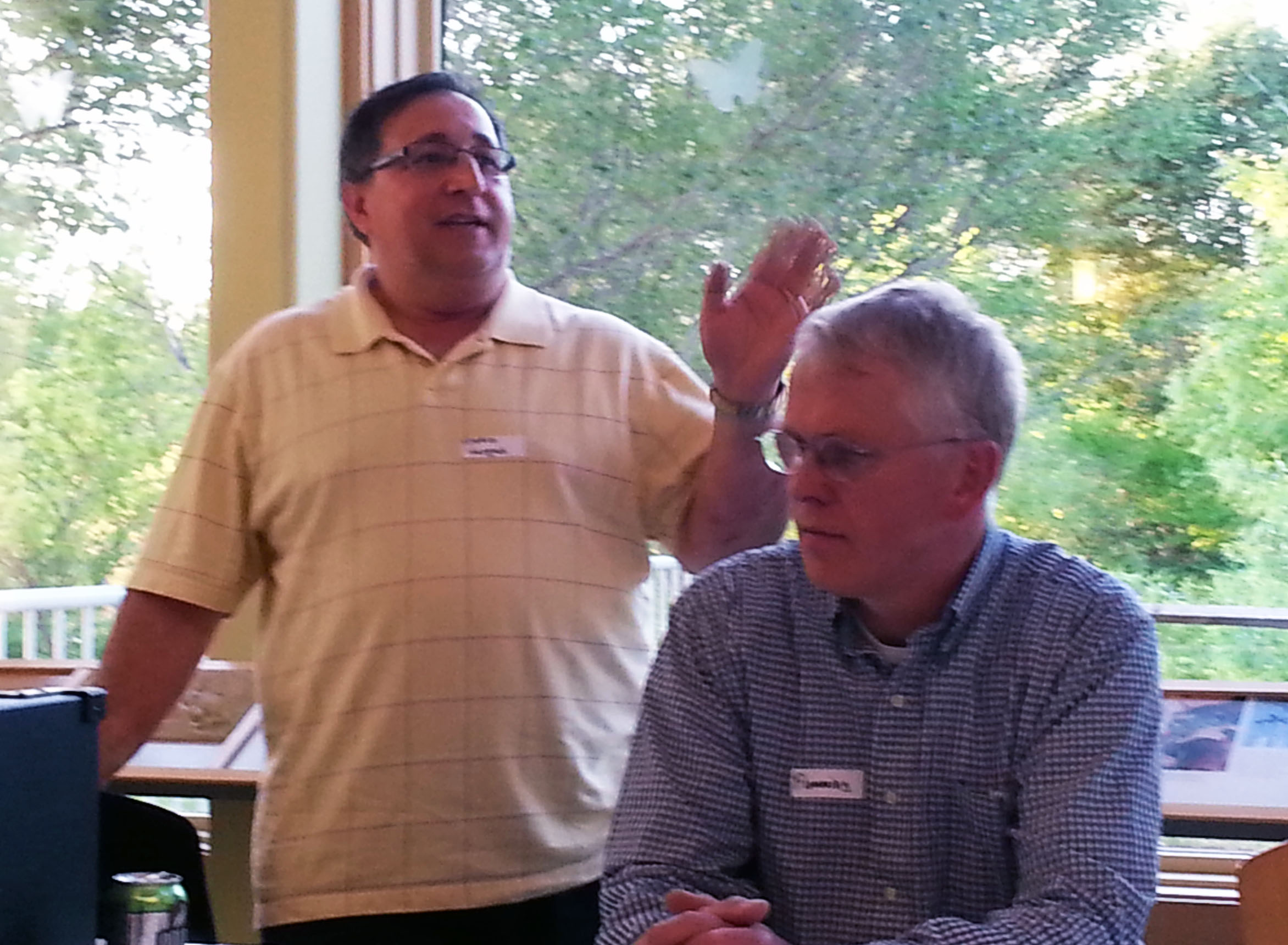Mario Vargas (left) spoke about post-ice-dam insurance claims at BBR's annual meeting, where he was joined by panelist Flemming Lund (right).