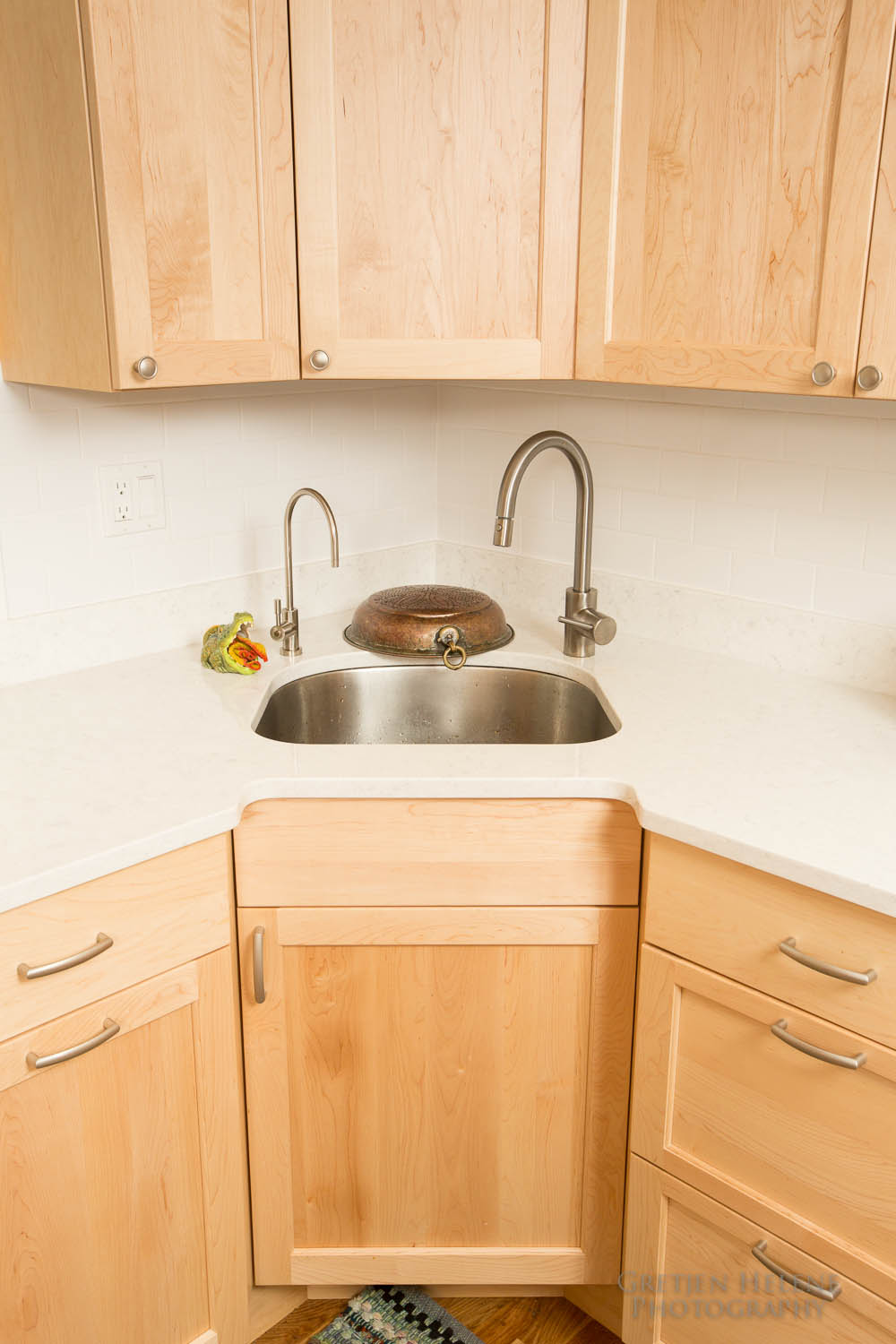 Quartz counter material with an undermount sink
