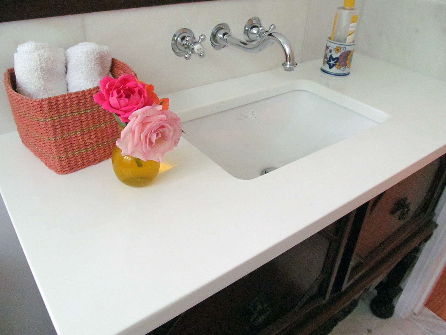 The vanity top and sink, both Reuse Center purchases, were installed on top of a sideboard that the homeowner had long owned.