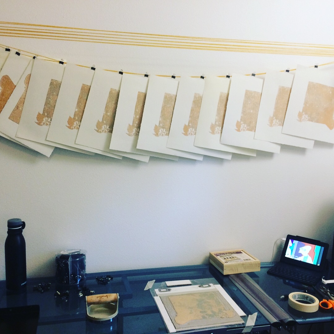 On the top of this image you can see the make-shift drying situation I rigged with yarn, binder clips, and some L brackets we had left over from construction. At the bottom you can see the carved block in it's jig, the barren, and of course Futurama on to keep me company.