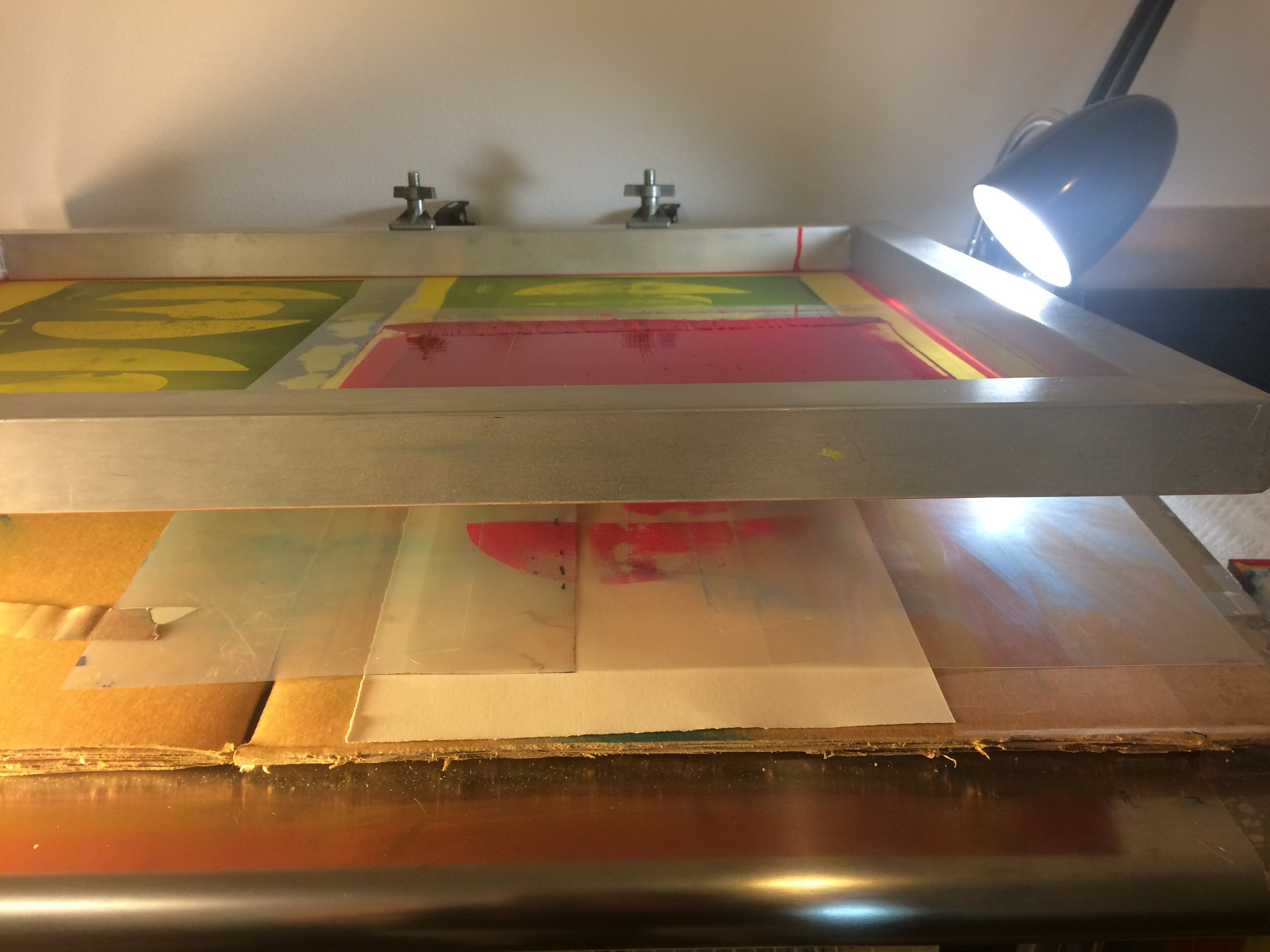 I am getting ready to lay down the magenta layer here, so to (try to) get the registration right I run the ink through once on a blank piece of transparent film.