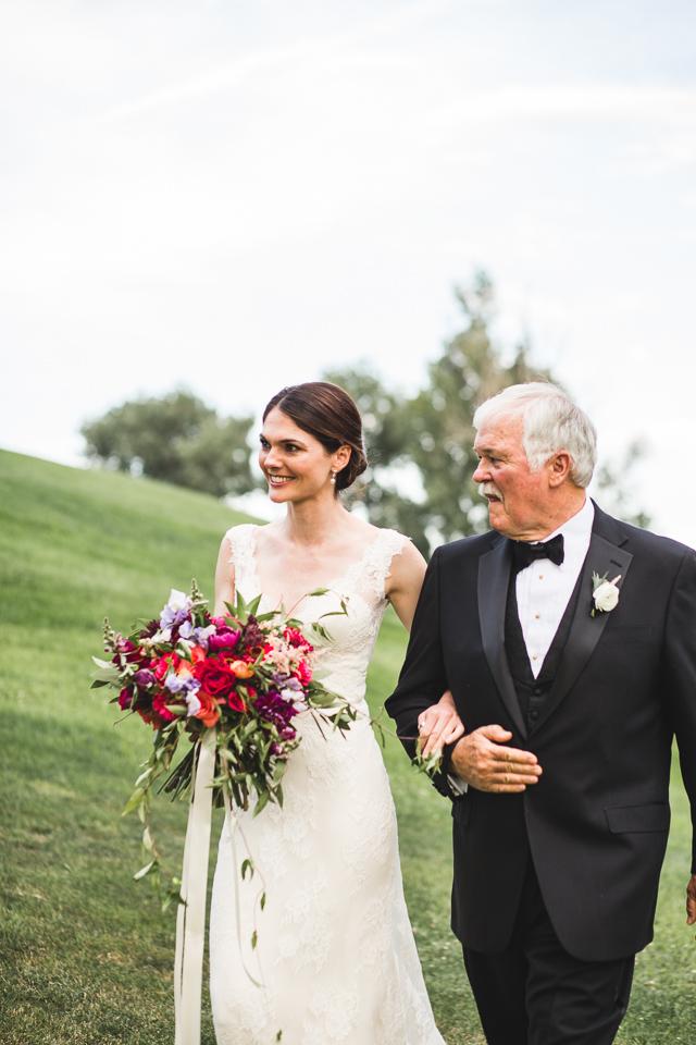 dad walking bride down the aisle on wedding day in denver colorado