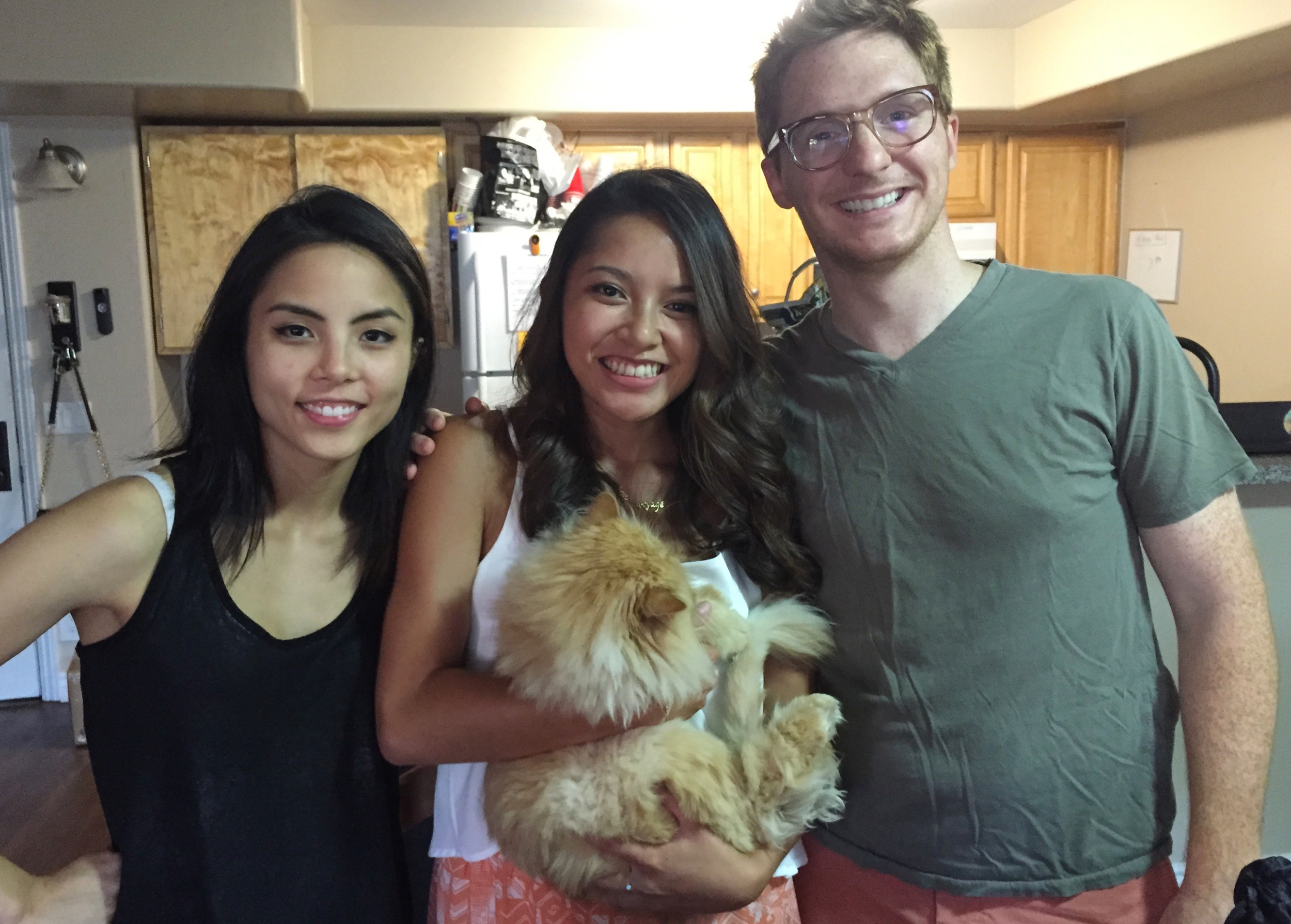 Anna Akanna, myself (Rebecca Garcia), Brad Gage oh and the kitty's name is Congress!