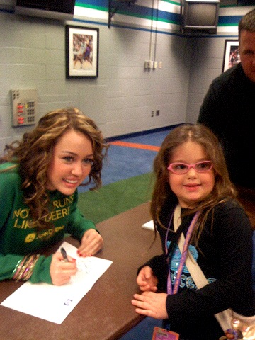 Miley Cyrus and Basha Goldwater  Backstage at Target Center / Minneapolis/Minnesota / October 21st,2007  Photoby Lisa Goldwater