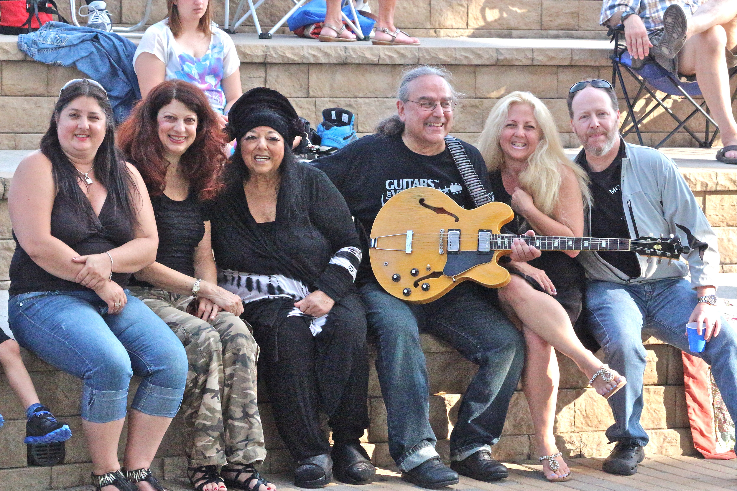Romy Percansky, Scarlet Rivera, Marilyn Percansky, Billy Hallquist, Lisa and Randy Goldwater / Salute to the Music of Bob Dylan / Town Green Amphitheatre / Maple Grove, Minnesota / August 6th, 2014 / Photo by Jeff Miletich