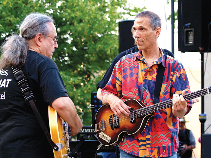 Billy Hallquist, left, and Gary Lopac, right, perform a Dylan tune at a Salute to the Music of Bob Dylan concert Aug. 9, 2014, at Veterans Memorial Amphitheater in St. Louis Park. (Submitted photo by Neil Schloner)