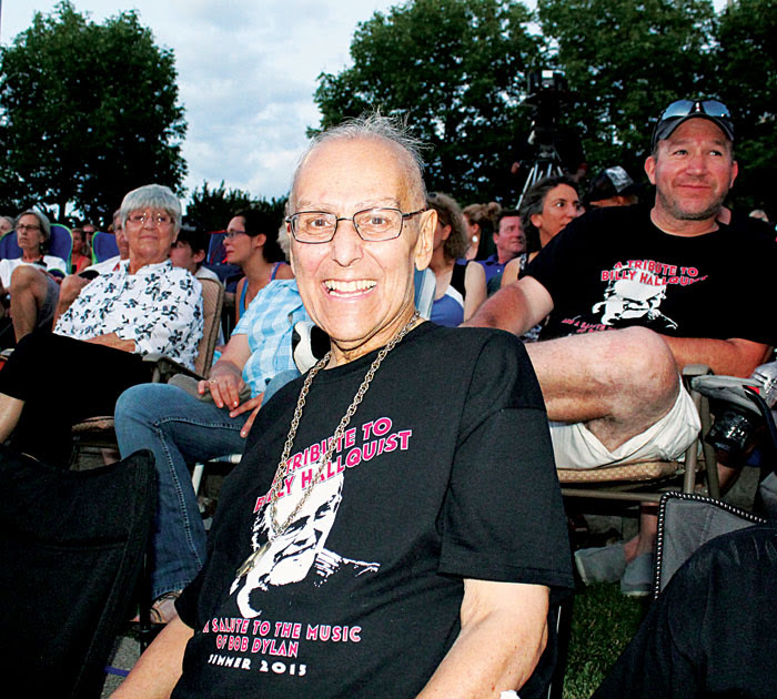 "Billy Hallquist, longtime organizer of the ""Salute to the Music of Bob Dylan,"" enjoys the show Aug. 1. Hallquist is battling concert, but the grinning musician was undeterred from making it on to a full stage to sing along in a closing number. Participants dubbed this year's shows in St. Louis Park and Maple Grove ""A Tribute to Billy Hallquist."" (Sun Sailor staff photo by Seth Rowe)"