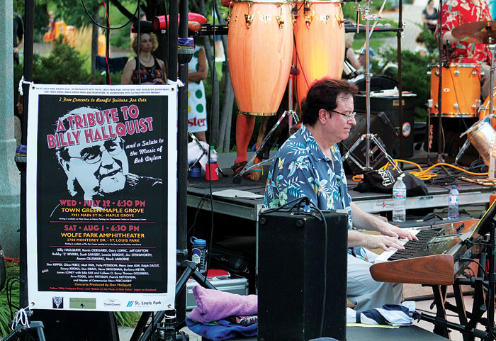 "Keyboardist Matt Fink, known as Doctor Fink when he performed with Prince and The Revolution, plays a Bob Dylan tune during a tribute to Billy Hallquist, longtime organizer of the ""Salute to the Music of Bob Dylan"" annual concerts at the Aug. 1 event in St. Louis Park. (Sun Sailor staff photo by Seth Rowe)"