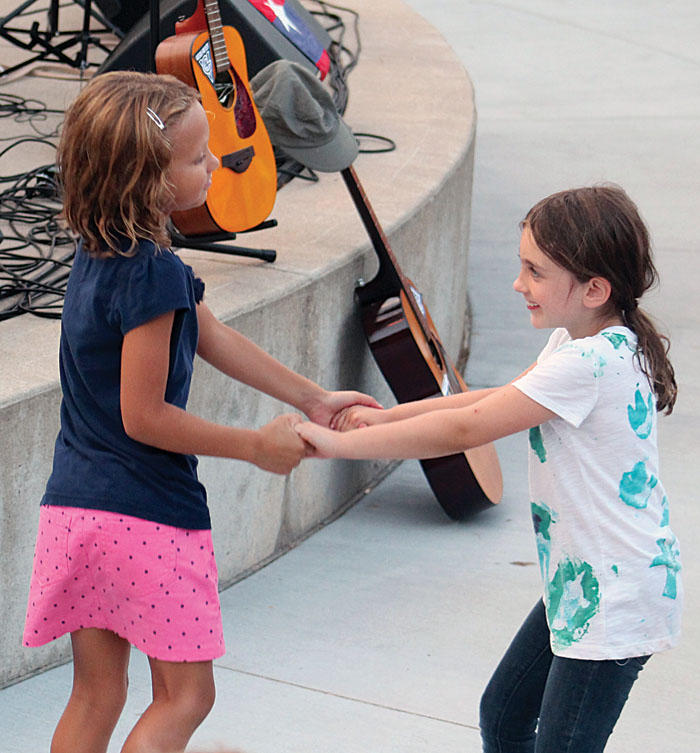 Two girls danced to the music of Bob Dylan Aug. 1 at Veterans' Memorial Amphitheater in St. Louis Park. (Sun Sailor staff photo by Seth Rowe)