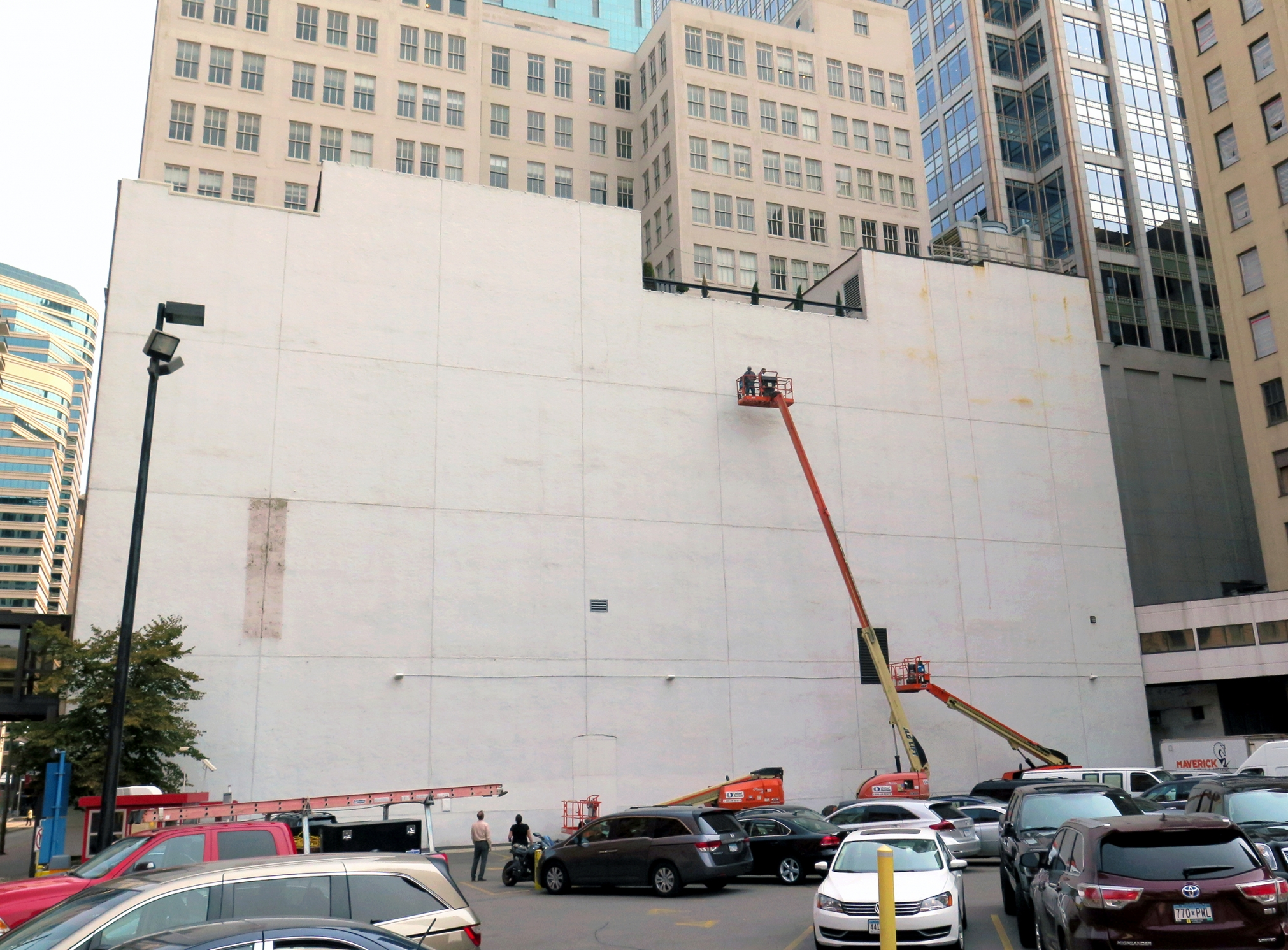 The blank white wall facing the corner of 5th and Hennepin Ave will become the 'canvas' for a mural by Brazillian artist Kobra- with an image of Bob Dylan. Photo taken 8/25 as work begins.