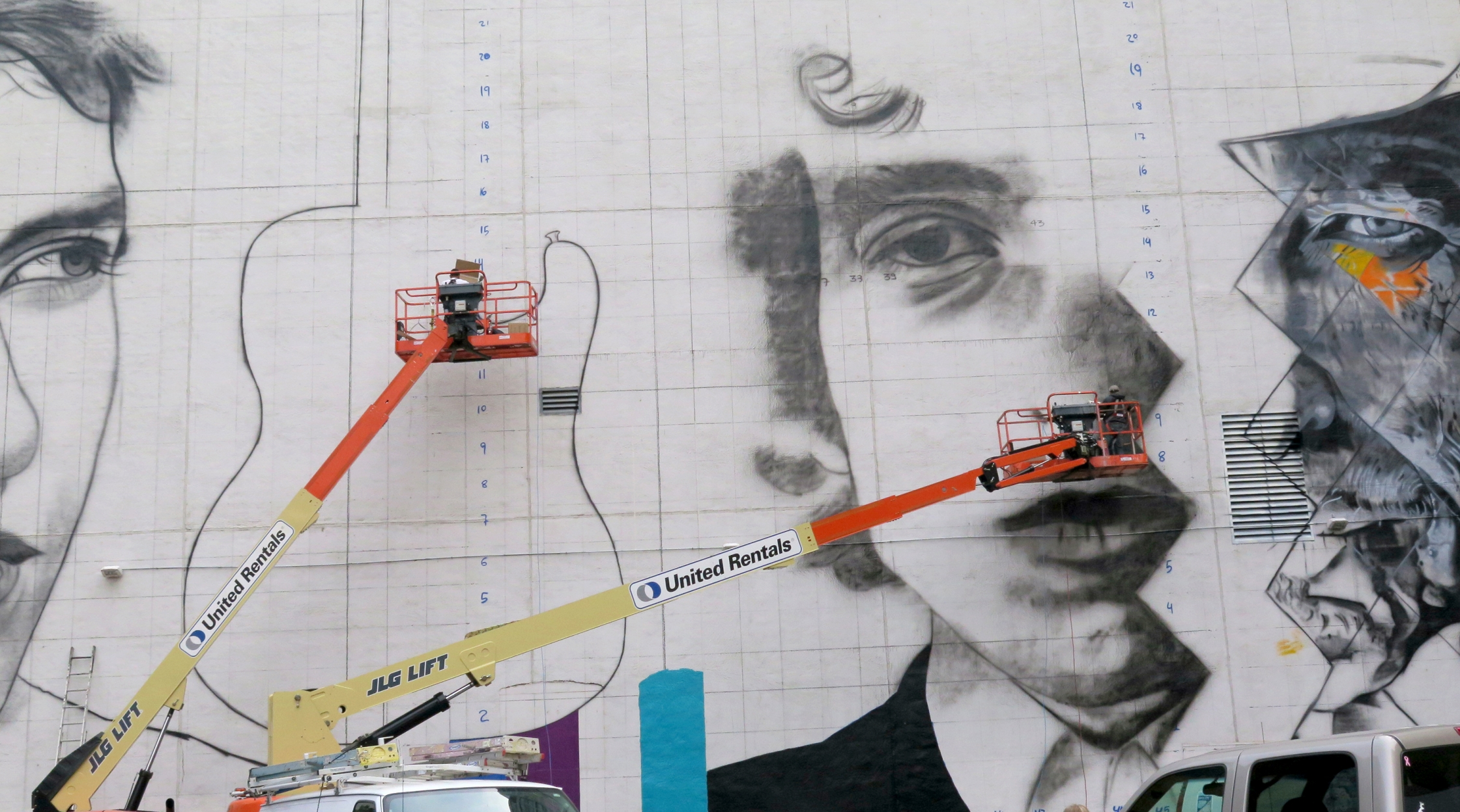 The work has begun and will continue over the next two weeks as Brazilian artist Eduardo Kobra and his team of five artists -- three from Brazil and two from Minnesota -- attack the blank wall using boom lifts and air compressors to create a three-paneled image of musician Bob Dylan.