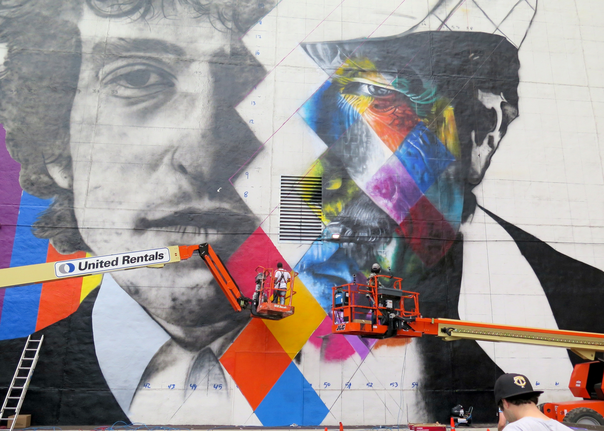 The 'canvas' for a mural by Brazillian artist Kobra- with multiple images of Bob Dylan takes on color, Friday 8/28.