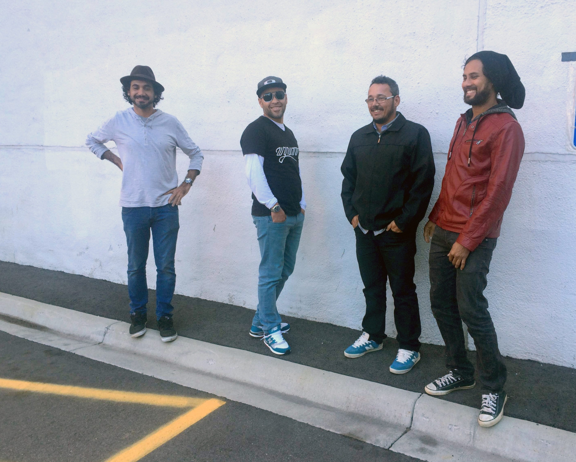 Brazilian street artist Eduardo Kobra (left) and his three team members -- Silvio Cesar de Almeida, Marcos Rafael da Silva and Agnaldo Brito Pereira -- at the site of upcoming mural on Fifth Street and Hennepin Avenue.