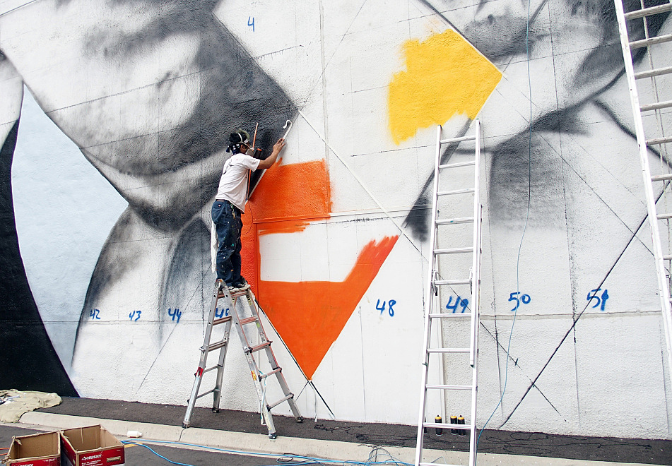 Minneapolis artist Yuya Nigishi stood precariously on a ladder to tape a line on the mural on August 27, 2015.