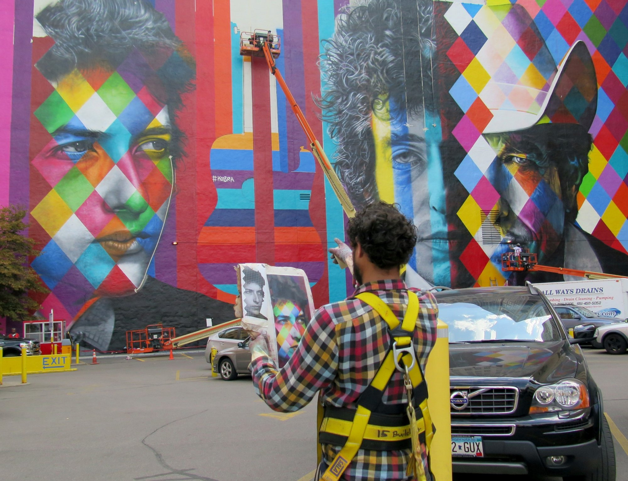 The Bob Dylan mural nears completion, Friday, Sept. 04, as one of the artists steps back to check his work.
