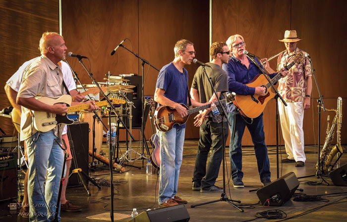 From left to right, Jeff Dayton, Gary Lopac, Dan Hallquist and Kevin Odegard and Steve Clarke perform July 20 at the Town Green in Maple Grove. (Submitted photo courtesy of Neil Schloner)