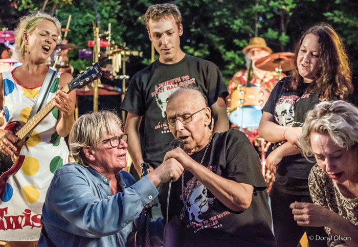 Billy Hallquist, at the microphone, sings as Kevin Odegard assists him at the 2015 Salute to the Music of Bob Dylan in St. Louis Park. (Submitted photo courtesy of Don J. Olson)