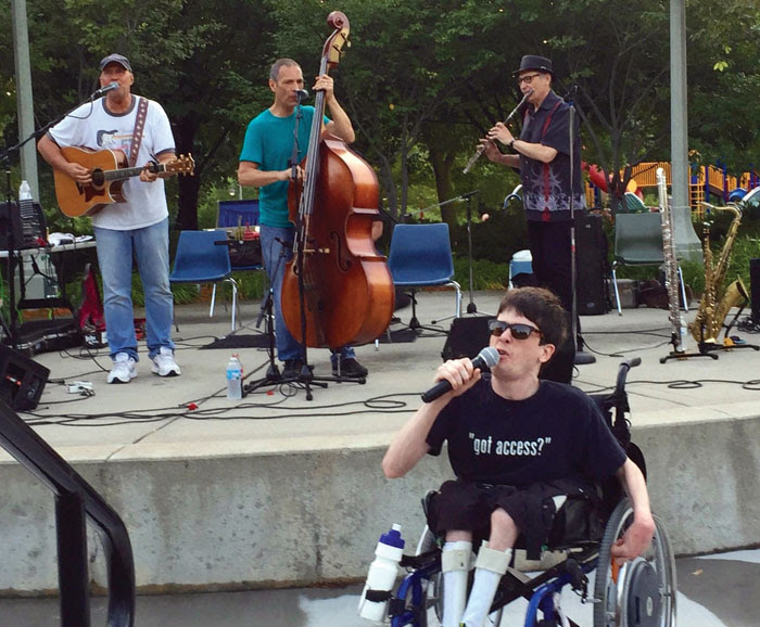 """Jeff Dayton, left, performs """"Like a Rolling Stone"""" with other musicians July 23 at Wolfe Park in St. Louis Park. (Submitted photo)"""