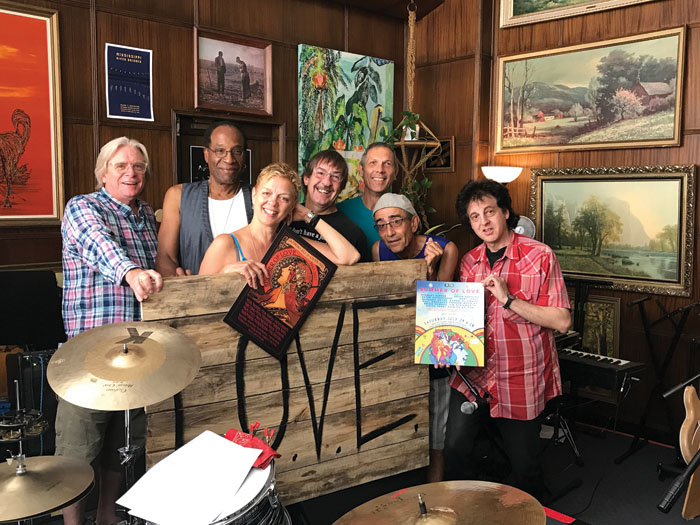Summer of Love Concert participants rehearse in Levi Stugelmeyer's studio in anticipation of the July 29 event. From left to right are Kevin Odegard, Stan Kipper, Barbara Meyer, Jim Steinworth, Gary Lopac, Chico Perez and Marc Percansky. (Submitted photo courtesy of Greg Galvin of Air Tech Thermex)