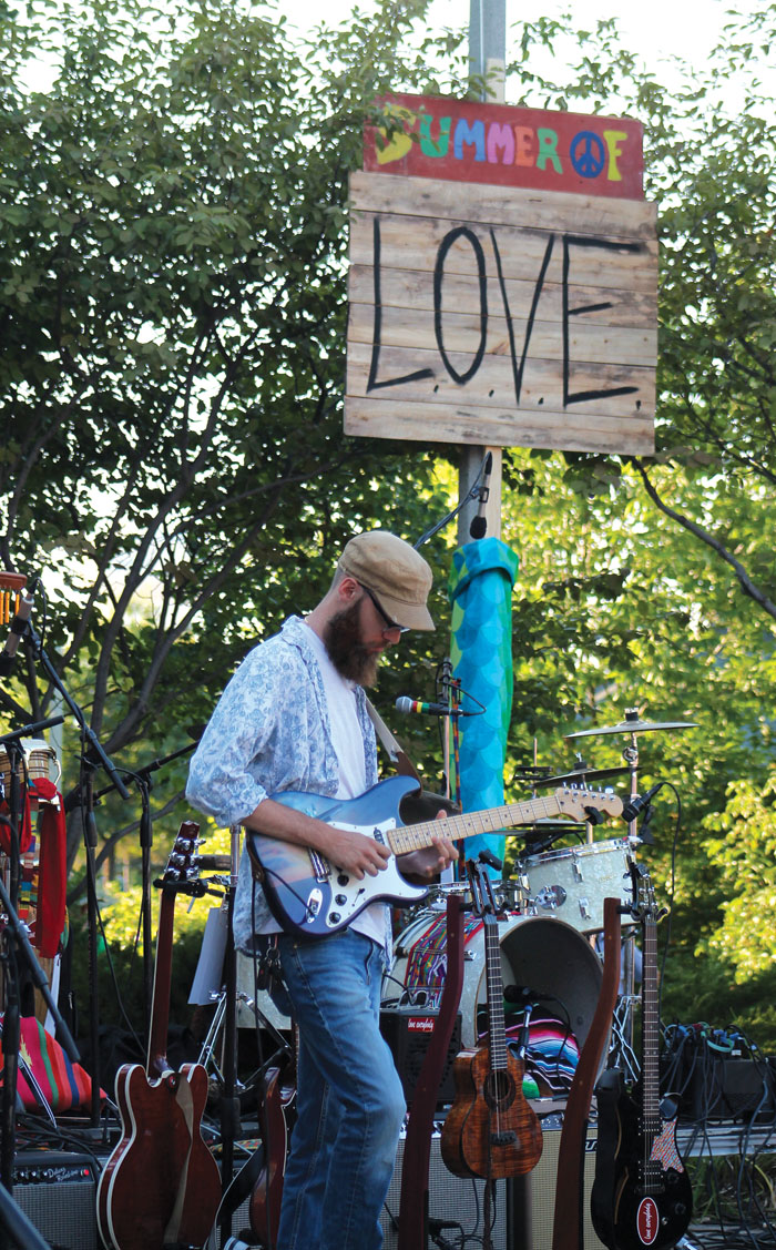 A banner proclaiming the Summer of Love adorned the Veterans' Memorial Amphitheater Stage during the concert paying homage to the season's 50th anniversary. (Sun Sailor staff photo by Seth Rowe)
