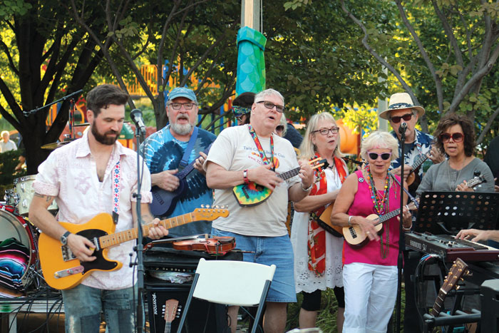 "The Twin Cities Ukulele Club performs ""Blowin' in the Wind"" July 29 in Wolfe Park. (Sun Sailor staff photo by Seth Rowe)"