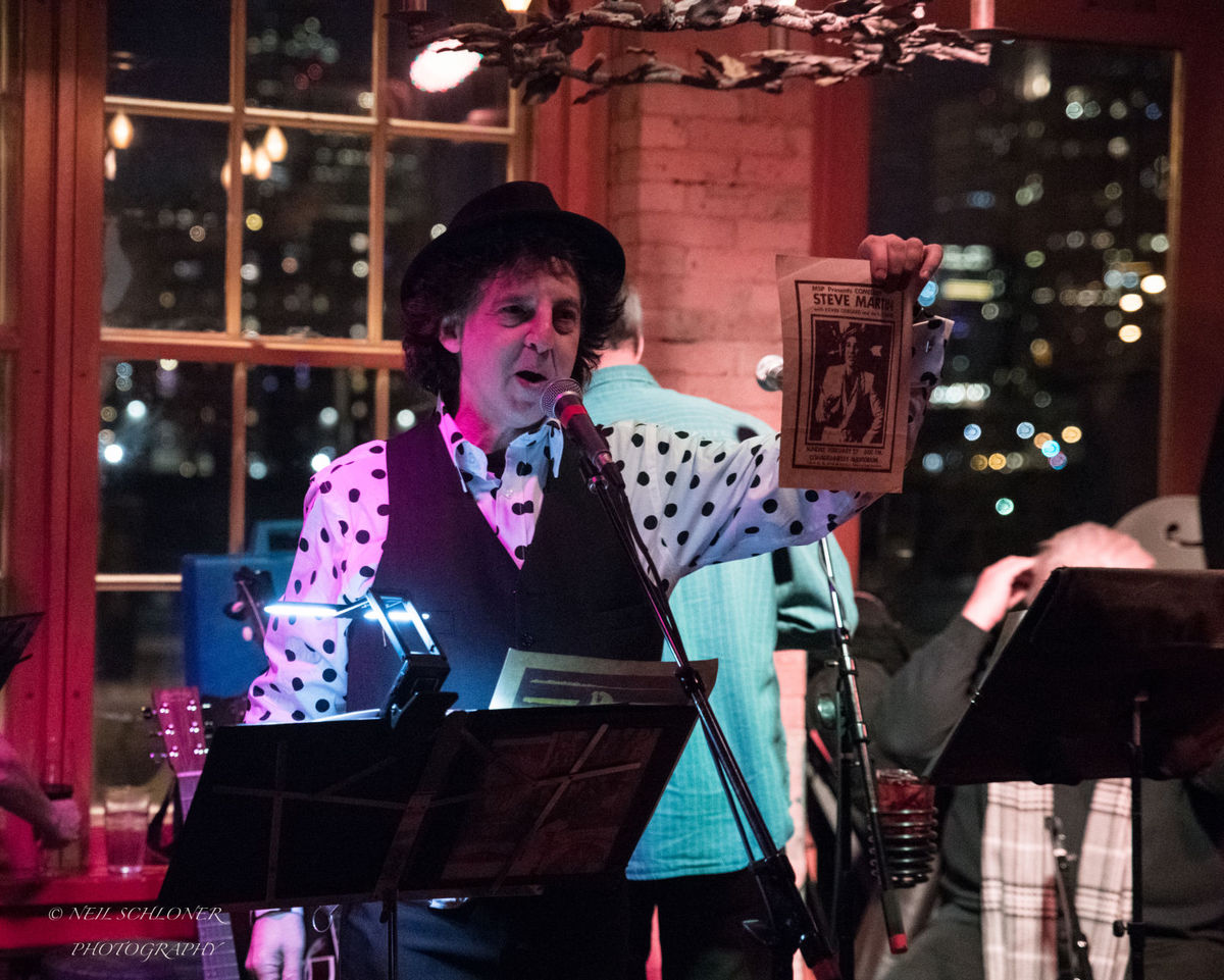 "St. Louis Park resident Marc Percansky shares a story about comedian Steve Martin during Kevin Odegard's ""Better Angels"" album release show at the Aster Cafe in Minneapolis. (Submitted photo courtesy of Neil Schloner)"