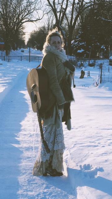 courtney-yasmineh-with-guitar-snowy.jpg