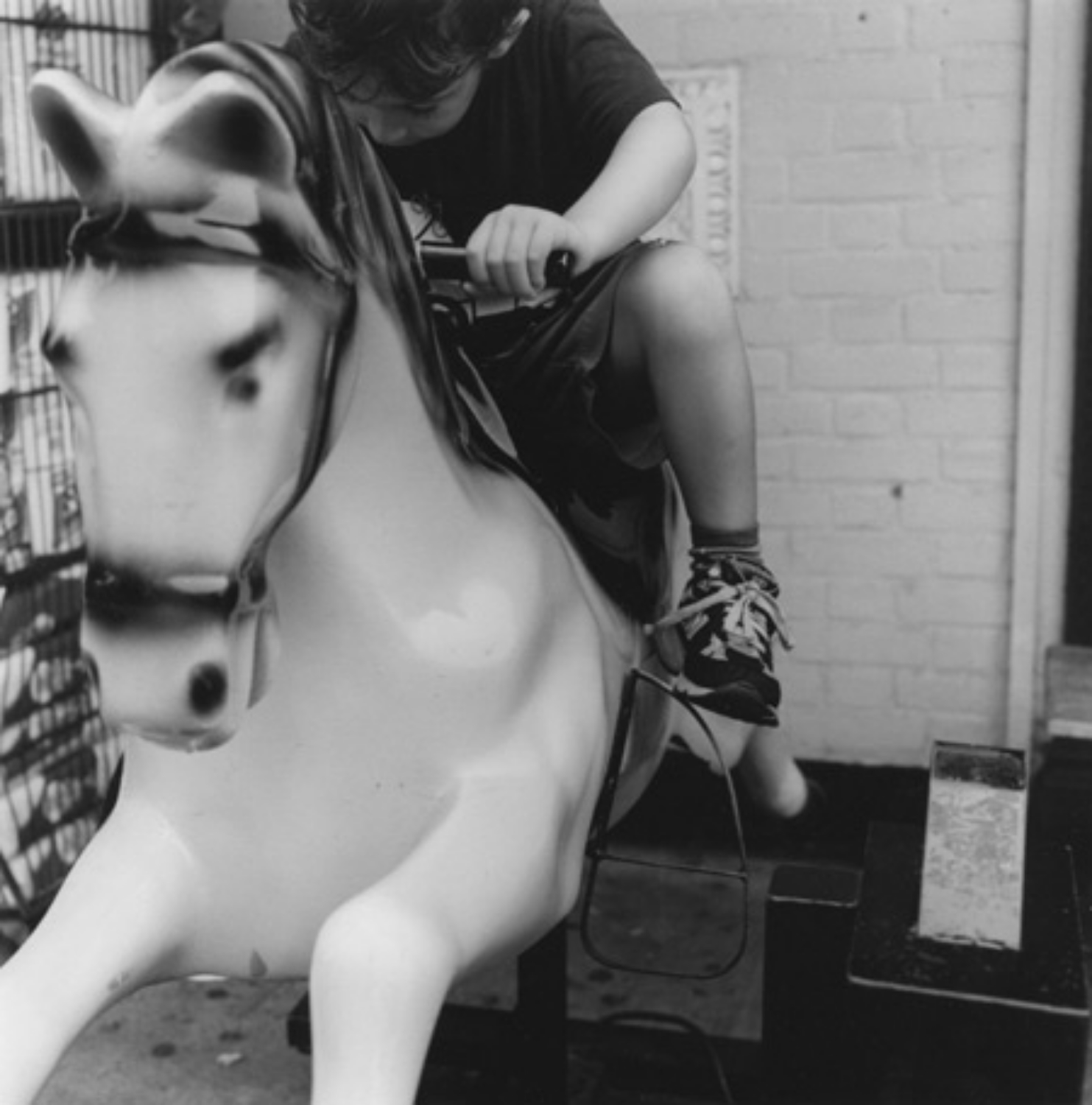 boy_on_coin_operated_horse 2003.jpg