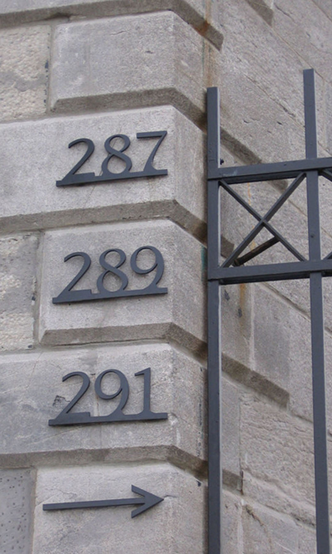 287 289 291 - The classic style of these numbers complements the architecture found on this grey-stone in Old Montreal condo building.Material: Stainless steelFinish: baked enamel semi-gloss blackThickness: 1/4 inchHeight: 4-inch numbers on 1/2 inch bar