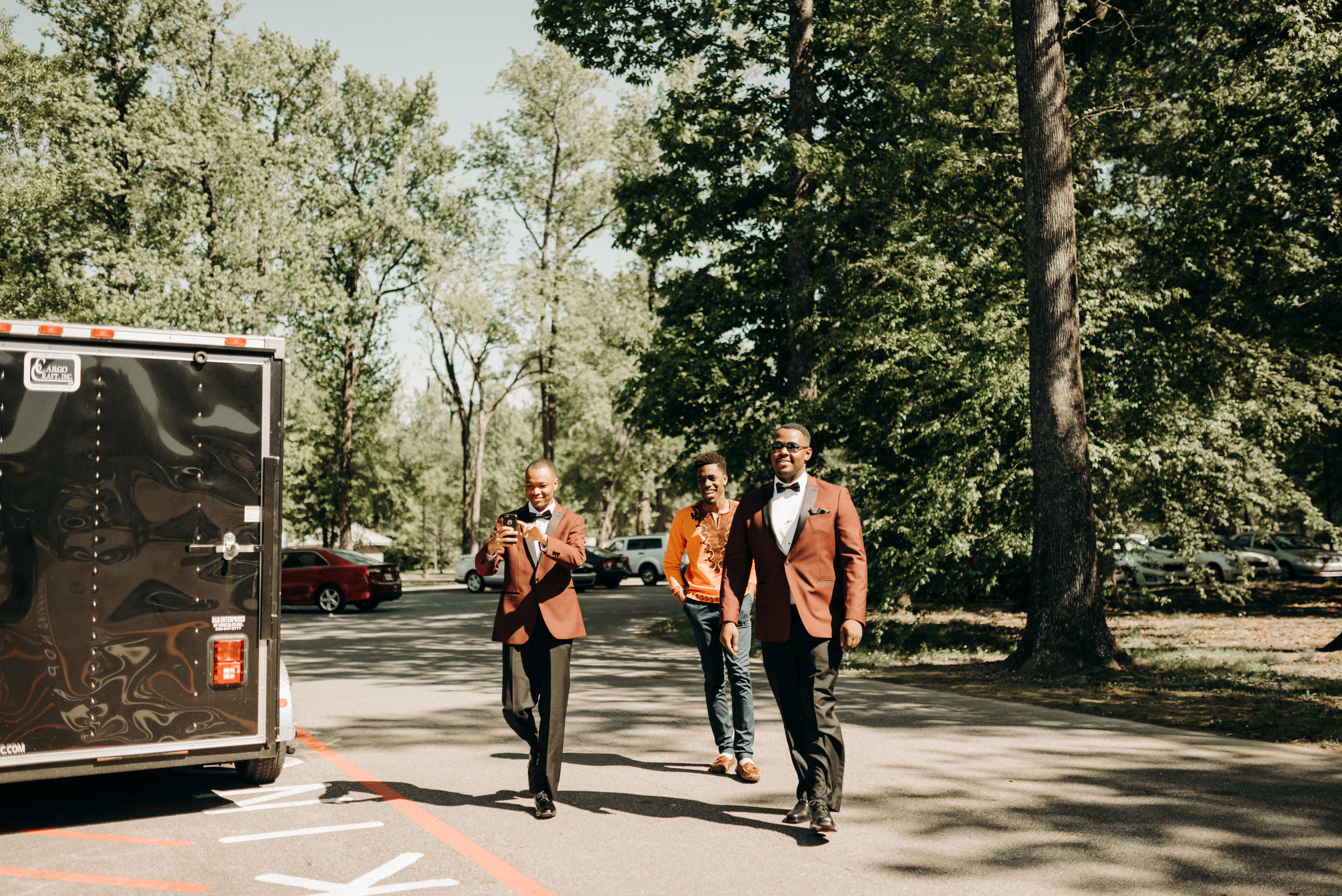 groomsmen walking towards the groom before a louisiana wedding