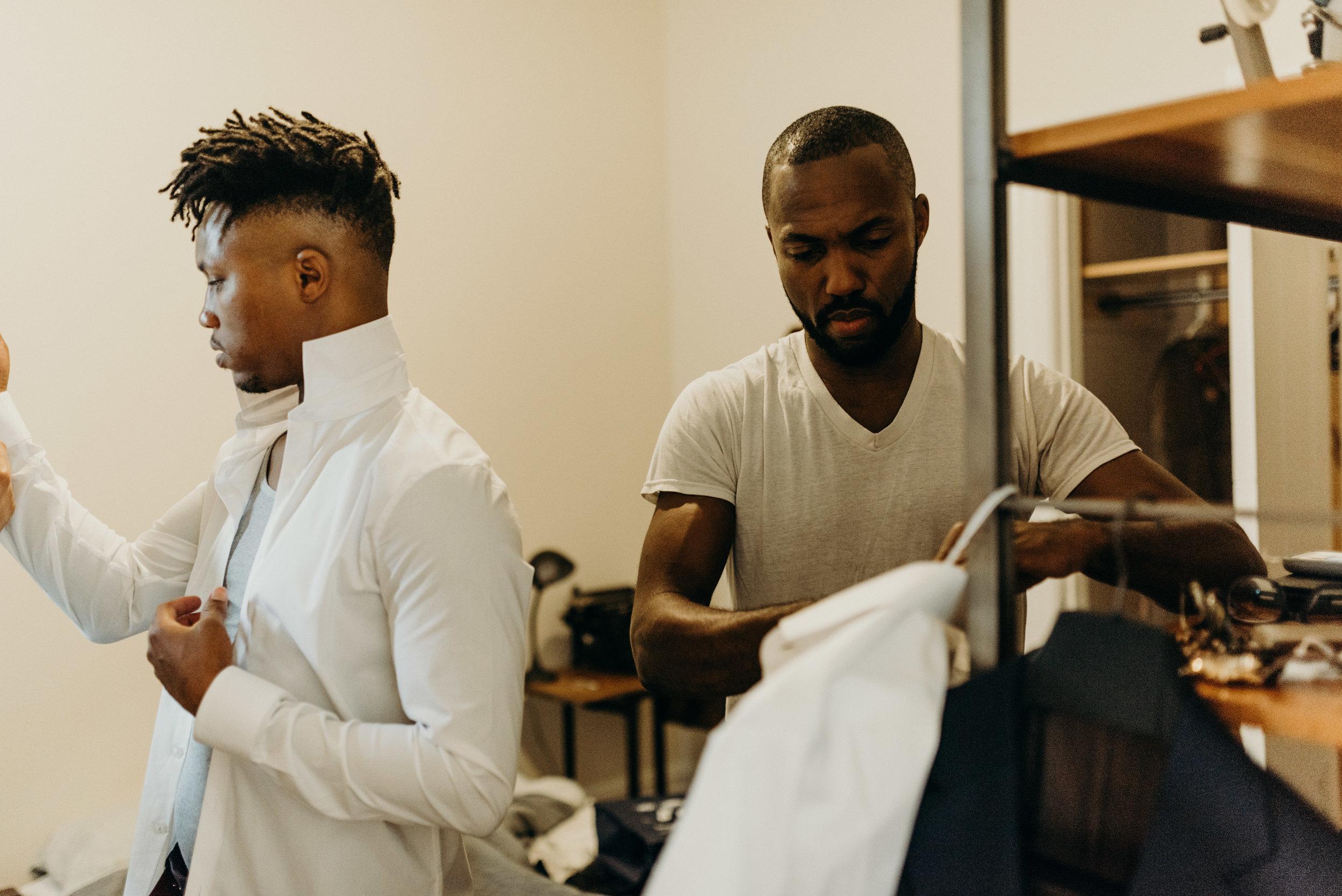 groomsmen get dressed in bedroom in san francisco
