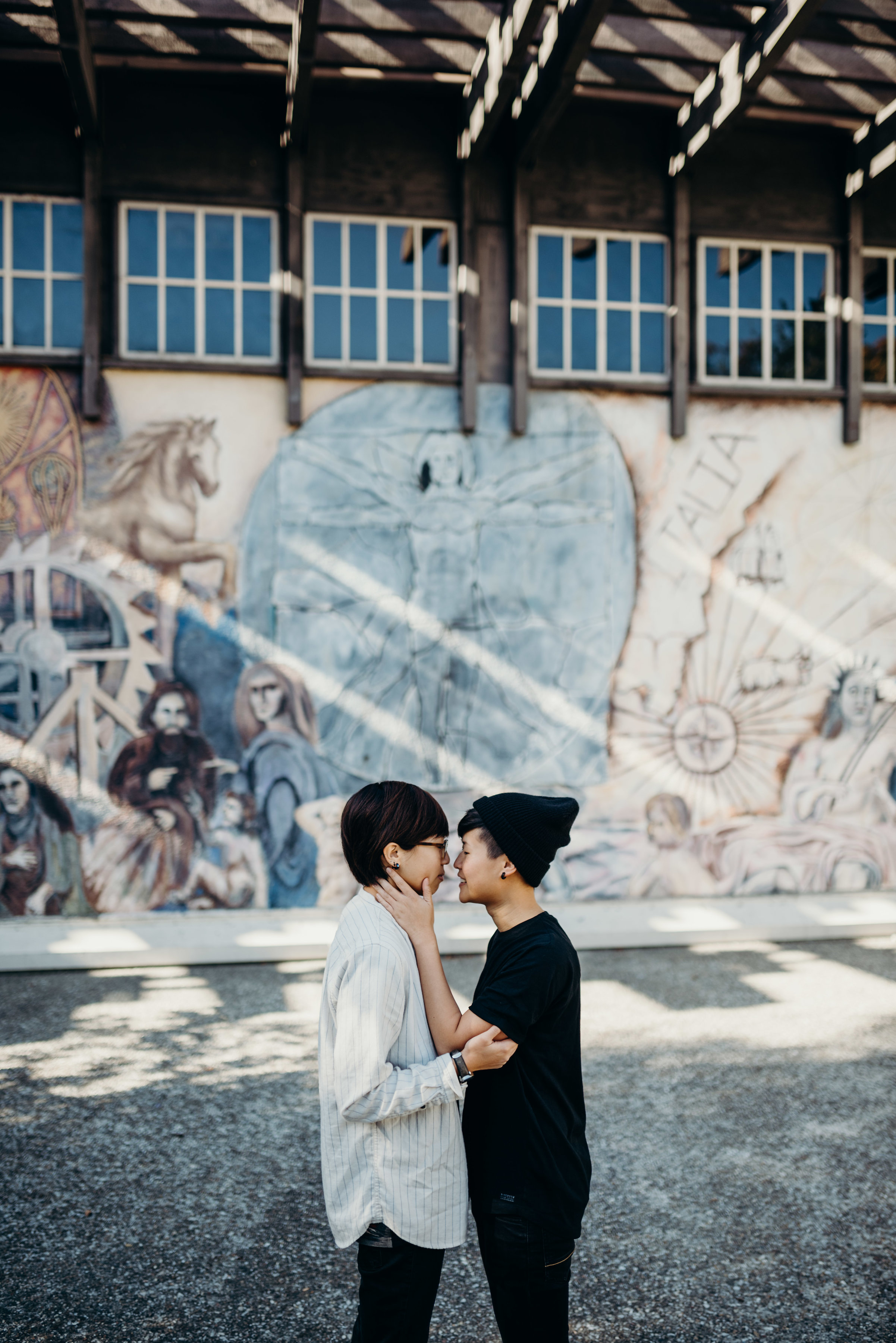 couple holding each other in front of graffiti in piedmont park