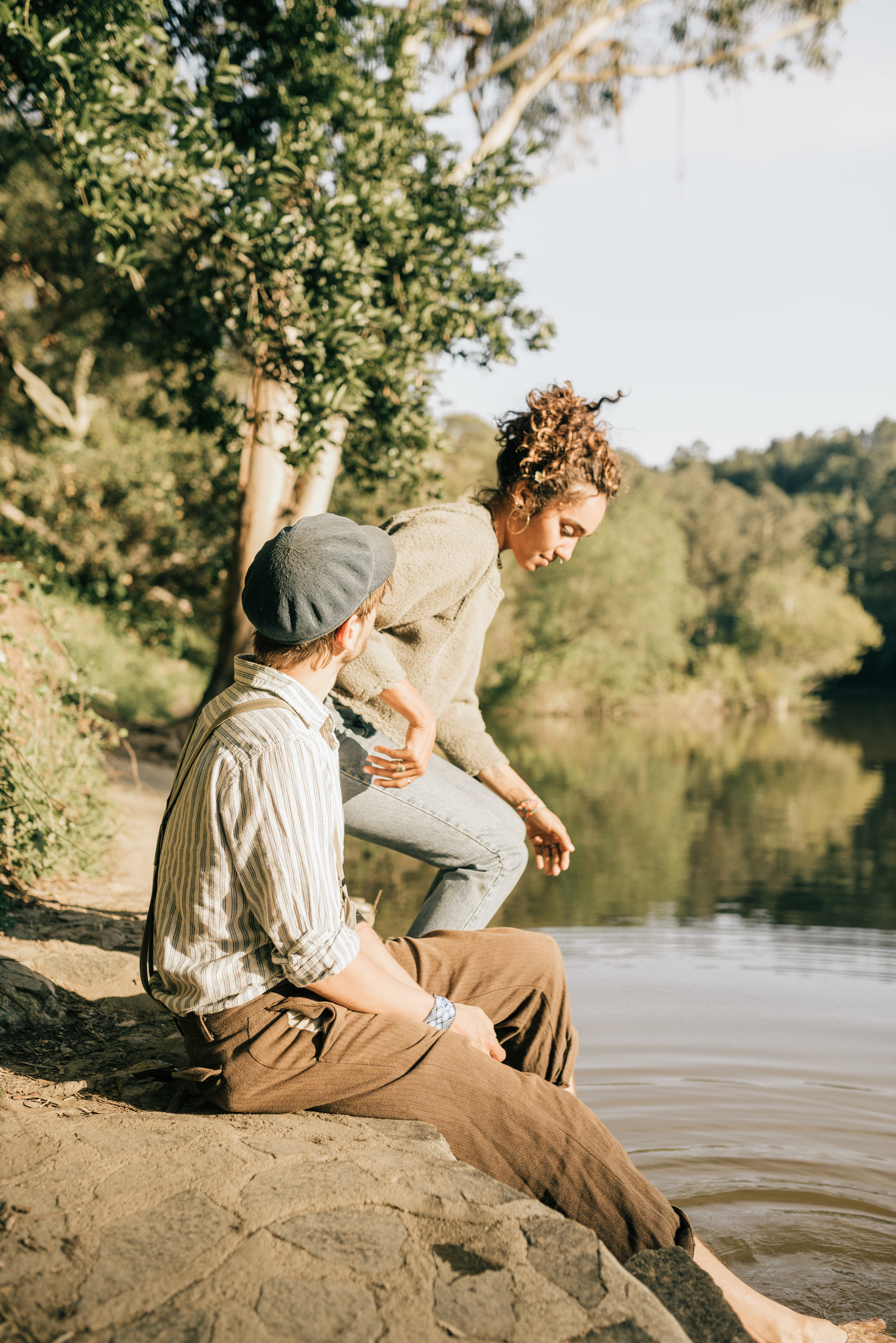 couple sitting next to lake anza. photo by oakland wedding photographer