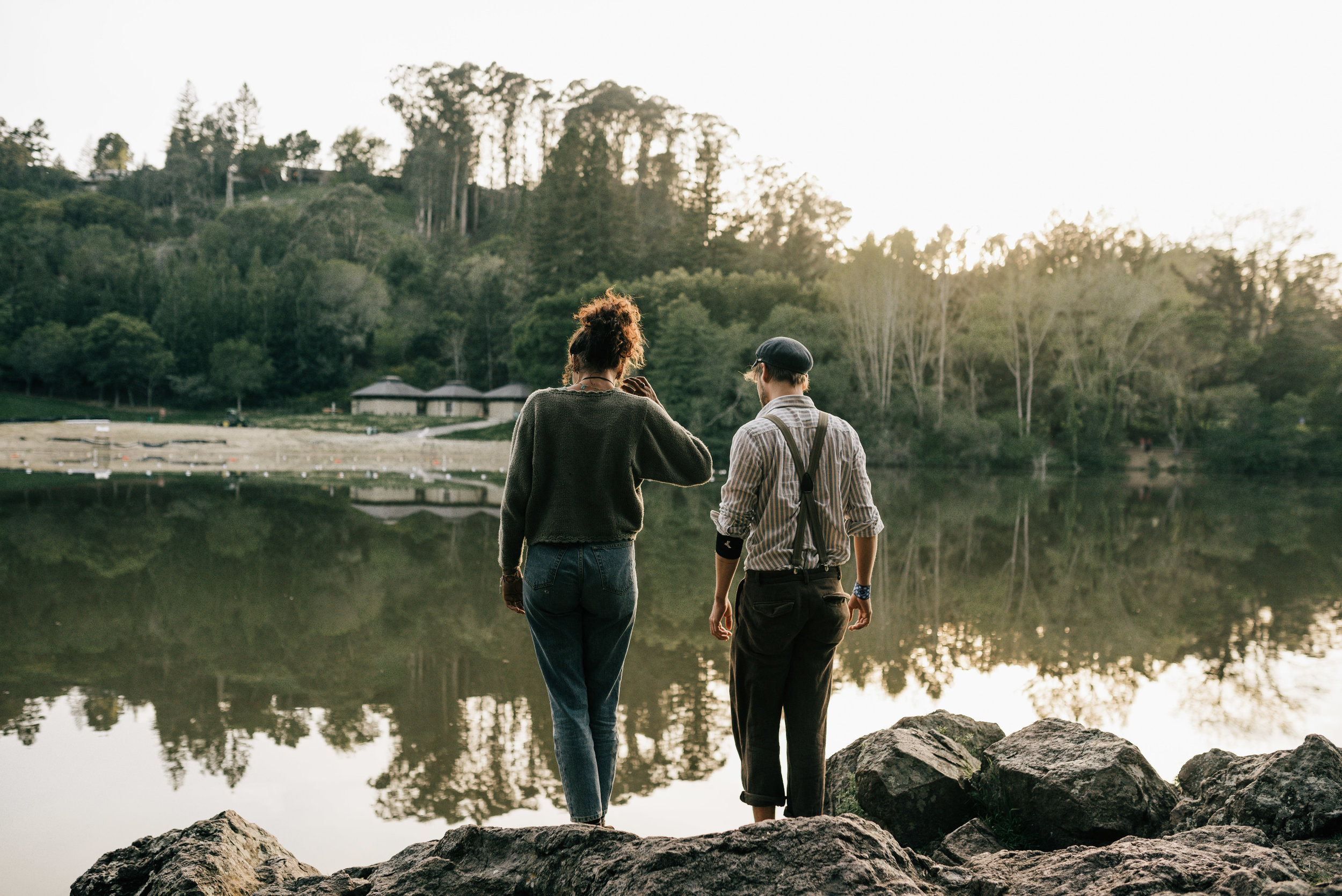 couple standing next to lake anza at sunset