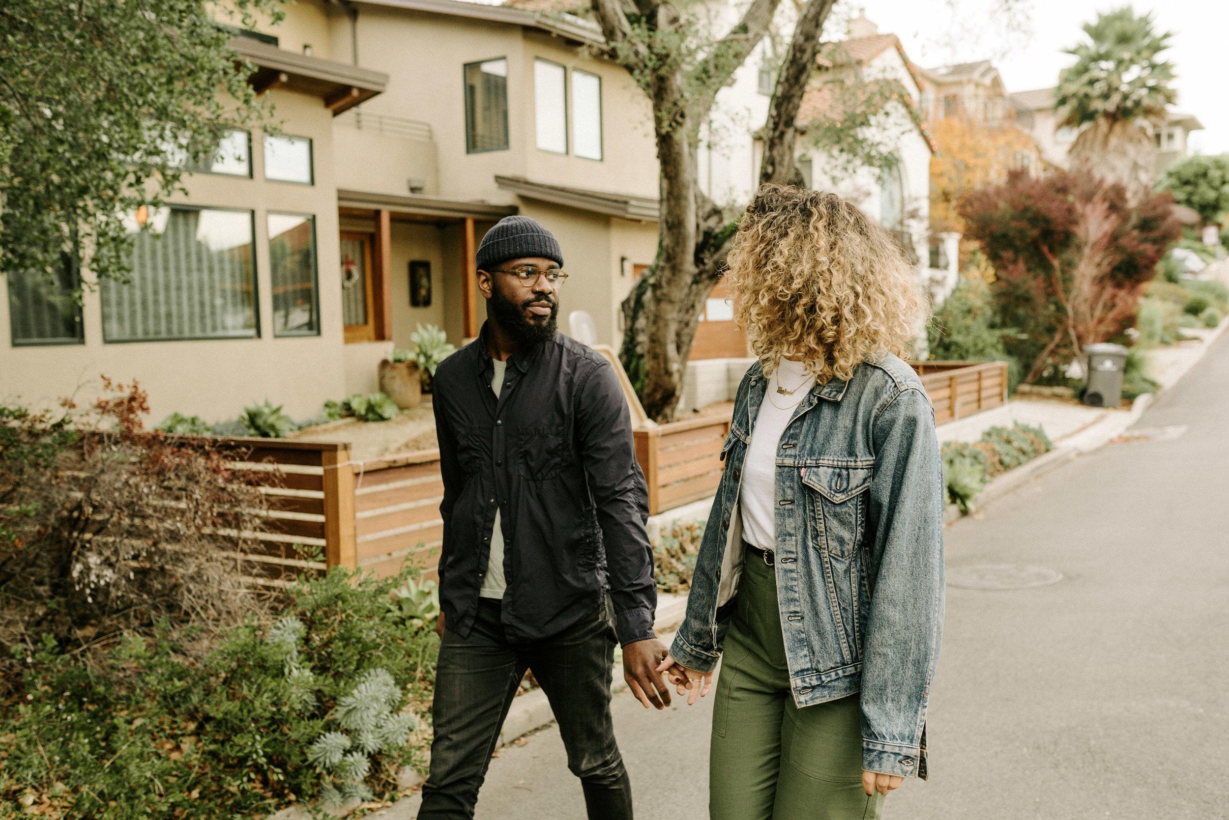 couple walking down the street in upper rockridge