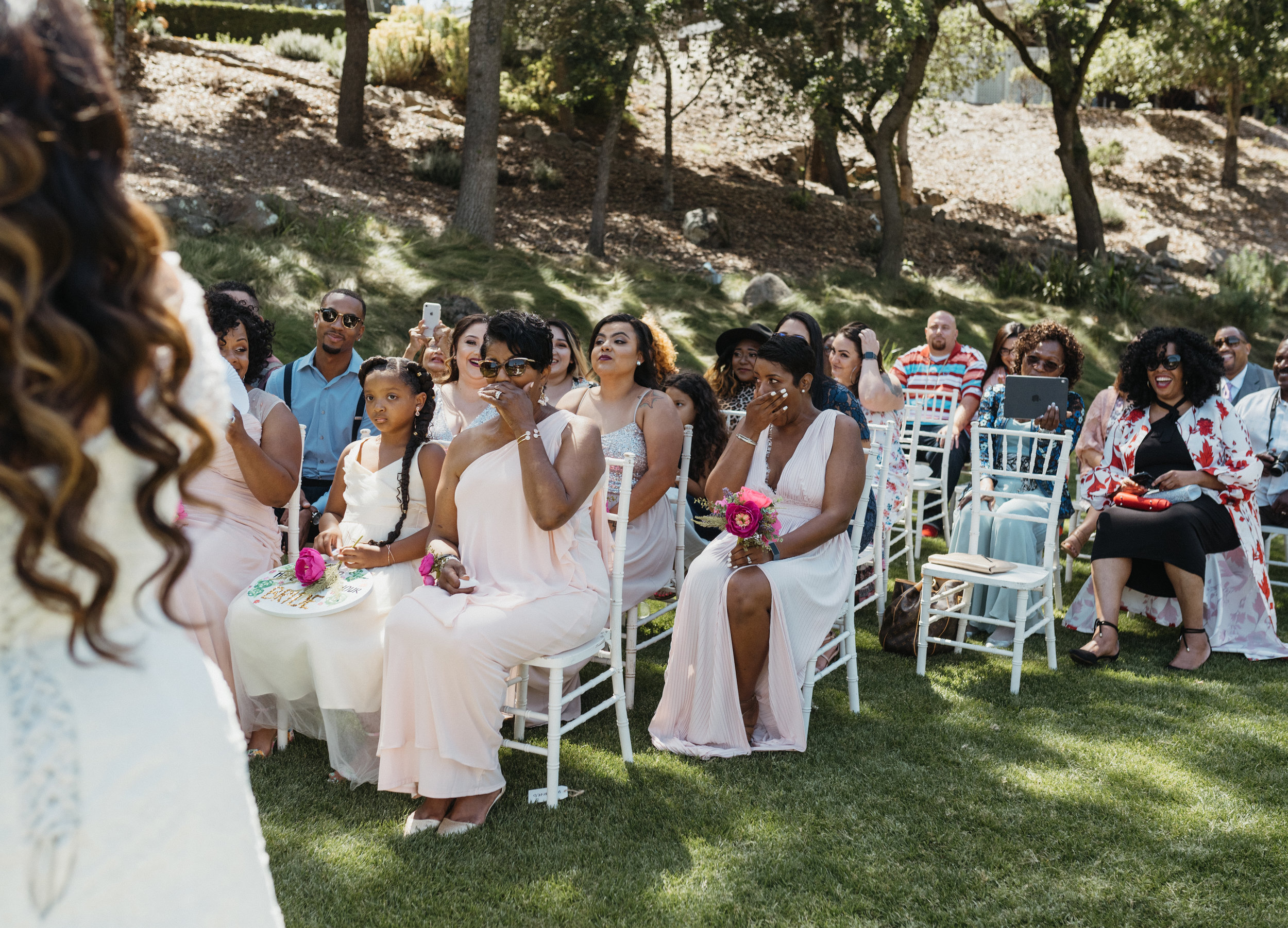 wedding guests at napa country club ceremony. photo by amira maxwell