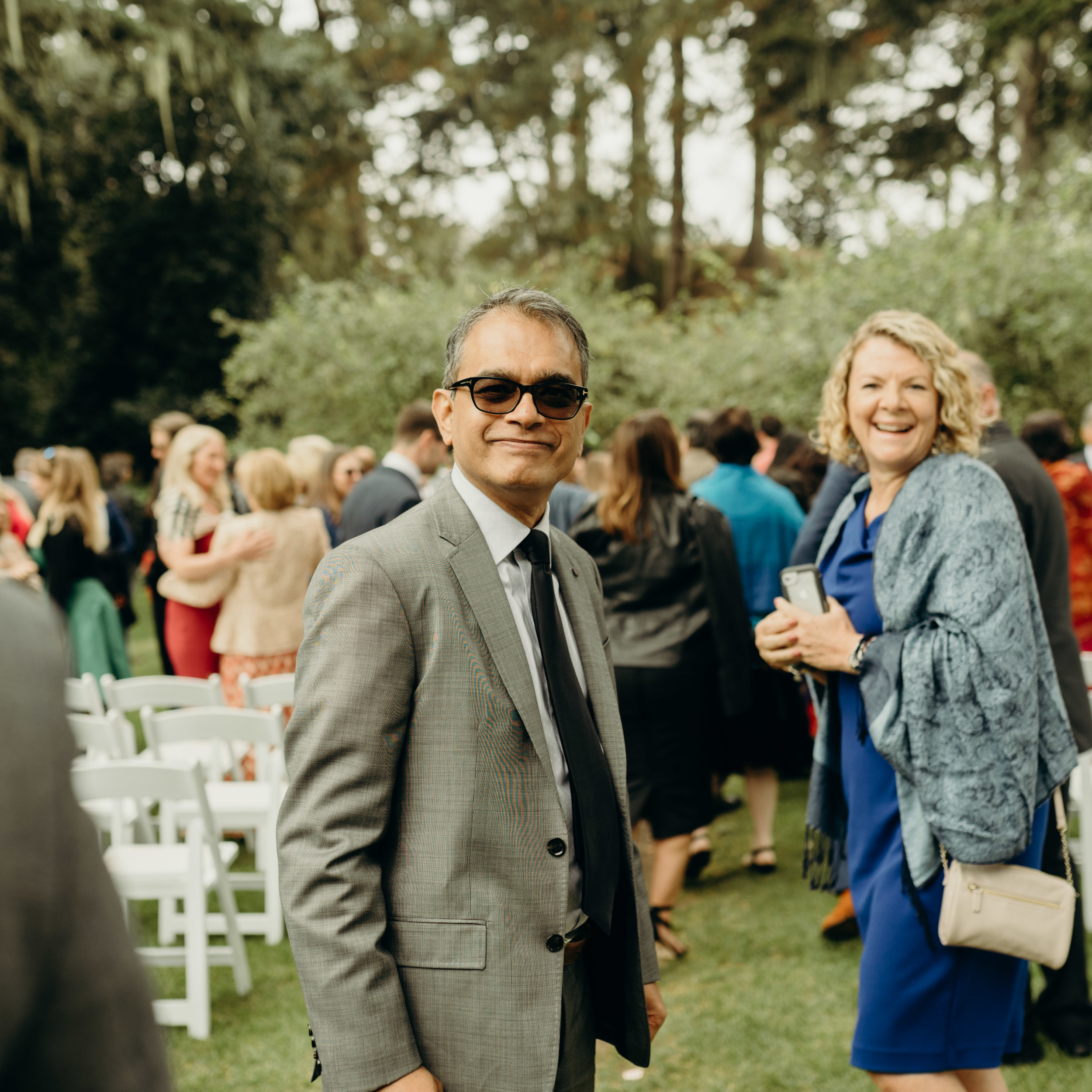 wedding guests at golden gate park's shakespeare garden wedding in san francisco. photo by amira maxwell