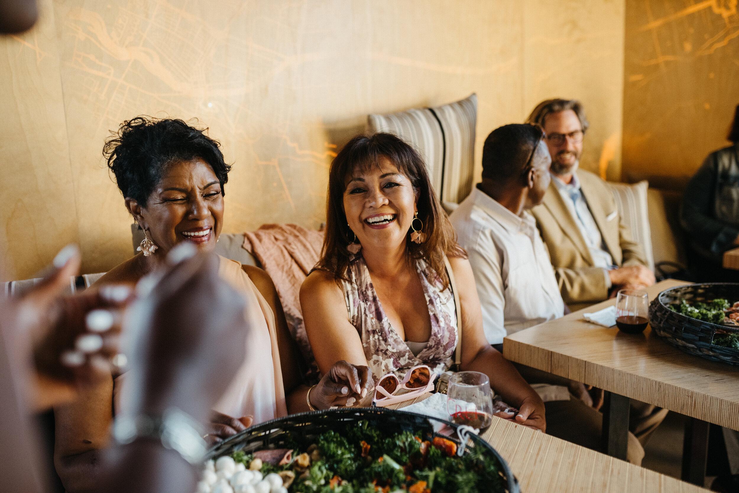 wedding guests laughing at napa wedding at cru winery. photography by amira maxwell