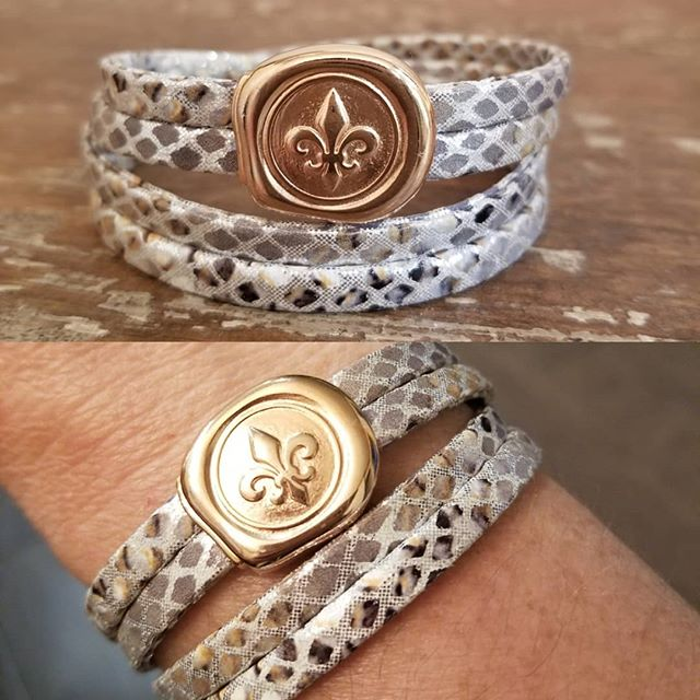 Well, hell-o beautiful! This 5mm Silver Snake Embossed Double Wrap with Rose Gold Fleur De Lis Clasp is quite unique, $30. Also available on black or brown.