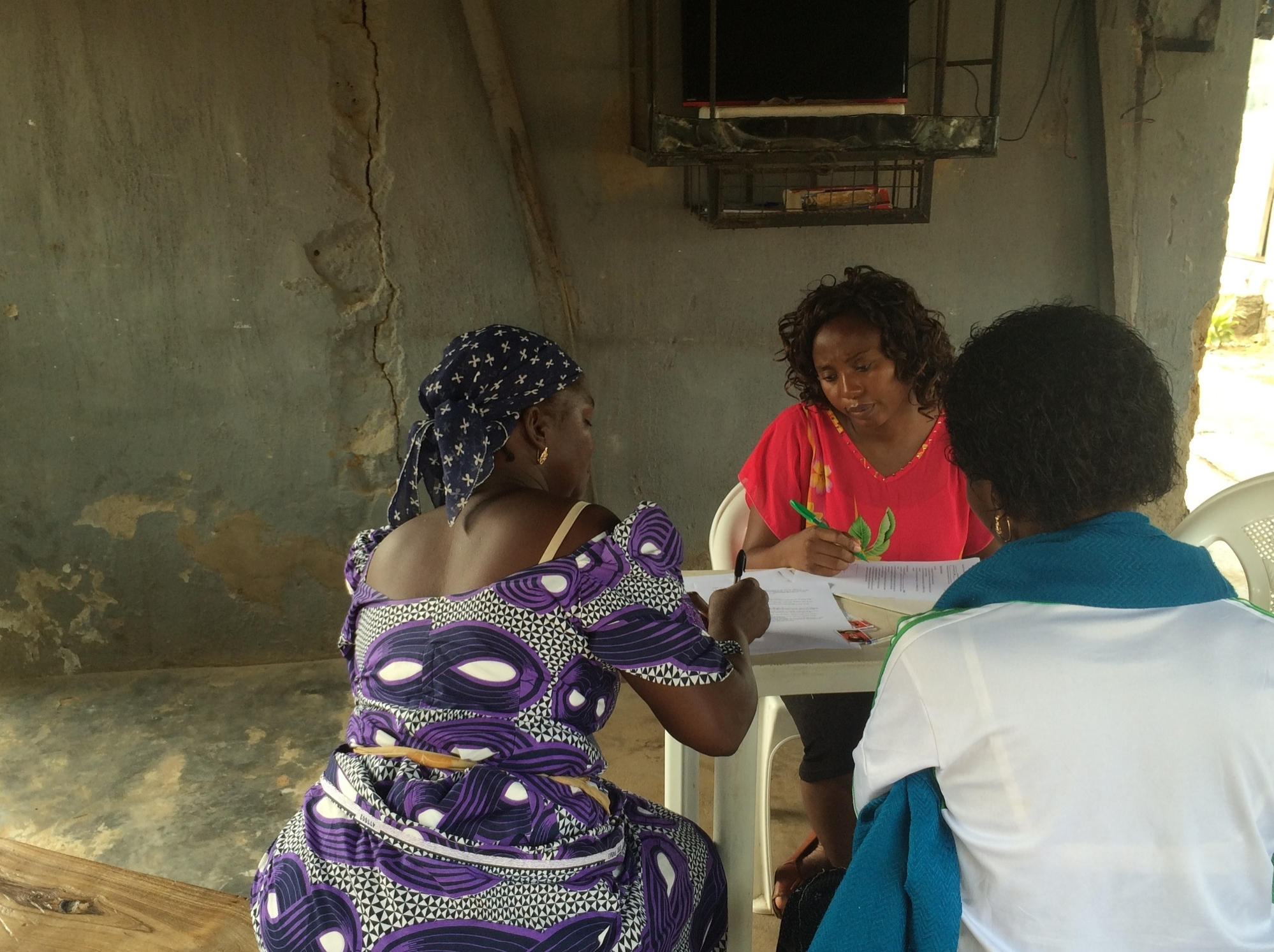 Franca Adah works with loan recipients on their business and repayment plans prior to loan distribution day.