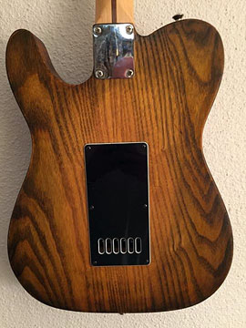 Custom stain technique with black acrylic, various shades of Amber dye stain and polyurethane.
