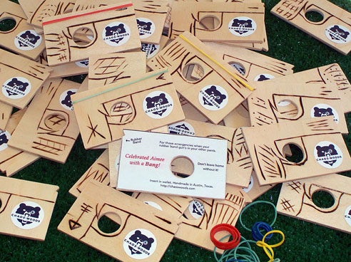 """Order for 50 emergency wallet rubber band gun party favors. Custom printed with """"Celebrated Aimee with a Bang!"""""""