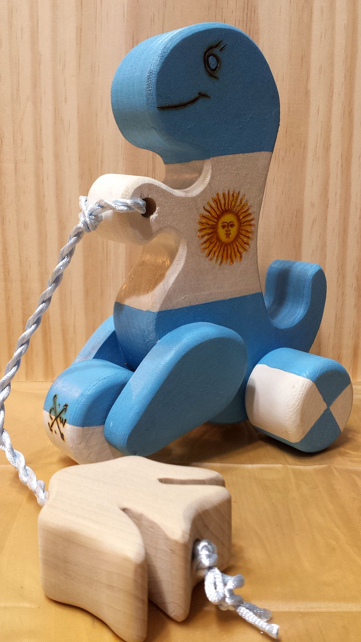 Dino pull toy hand painted with the Argentine flag
