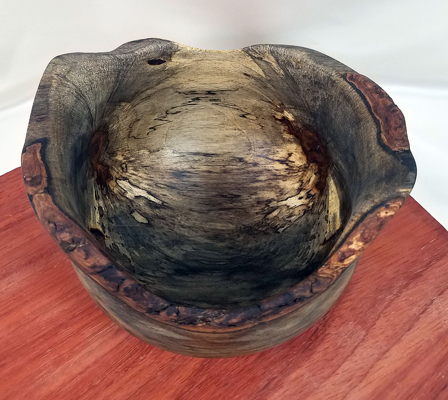 Spalted explosion inside of the bowl looks like marble.